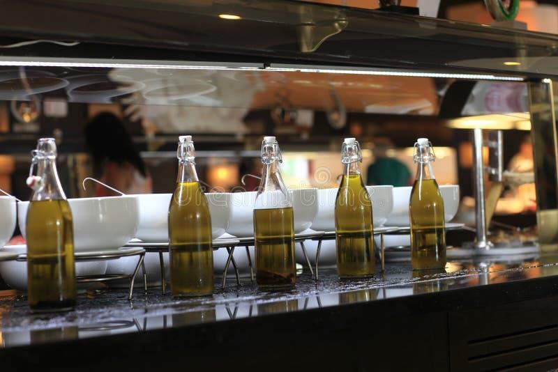 Flaskor med olika typer av olivolja royaltyfri foto
