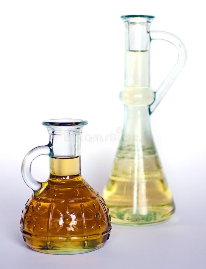 flaskor oil två royaltyfri bild