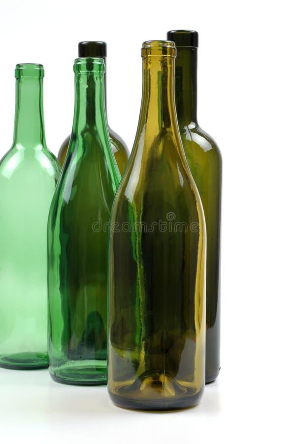 flaskor tömmer wine royaltyfria bilder