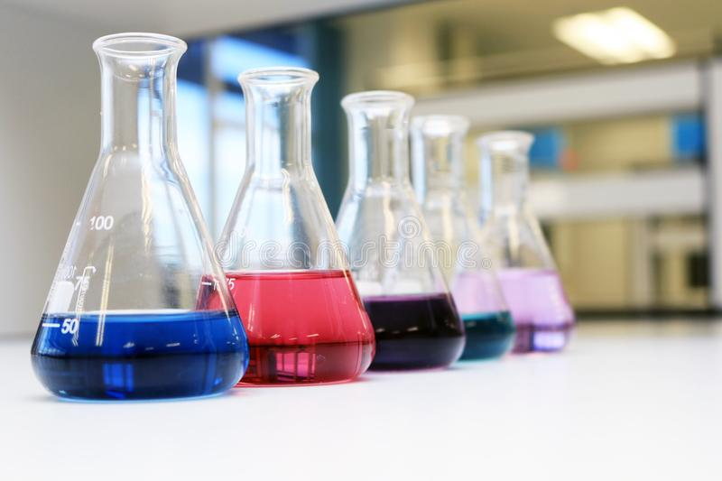 Flasks with solution or chemical in science classroom and laboratory. royalty free stock images