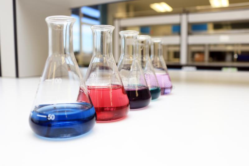 Flasks with solution or chemical in science classroom and laboratory. stock photos