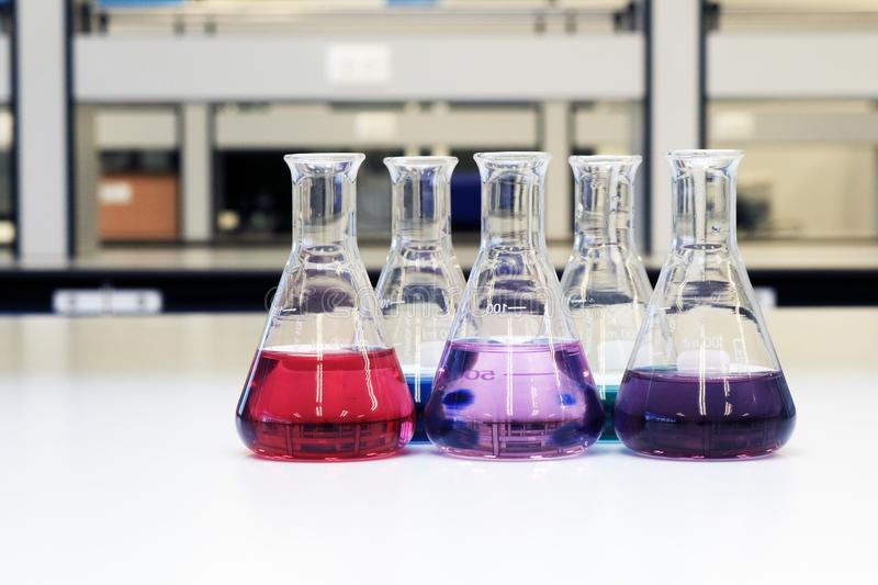 Flasks with solution or chemical in science classroom and laboratory. stock images