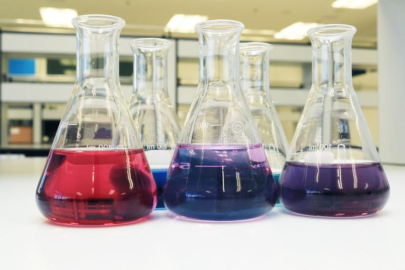 Flasks with solution or chemical in science classroom and laboratory. stock photography