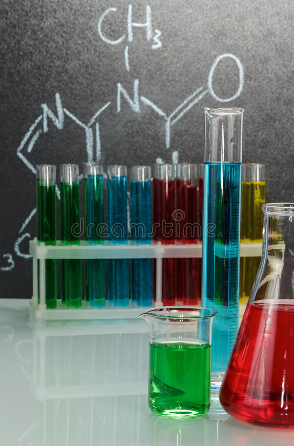 Flasks and test tubes with liquid on background laboratory. stock photos