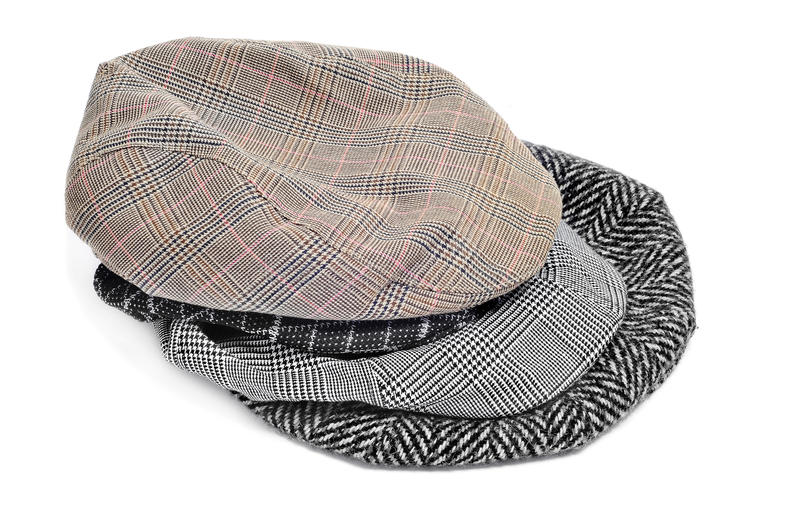 Download Flat caps and bonnets stock photo. Image of checked, cold - 18156736