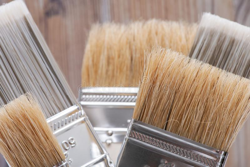 Flat Chip and Flat Cut Utility Paint Brushes   on wood royalty free stock photos