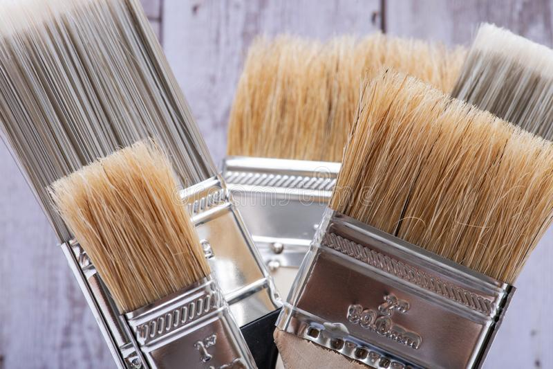 Flat Chip and Flat Cut Utility Paint Brushes   on wood stock photos