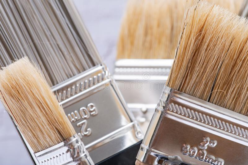 Flat Chip and Flat Cut Utility Paint Brushes   on wood royalty free stock photography