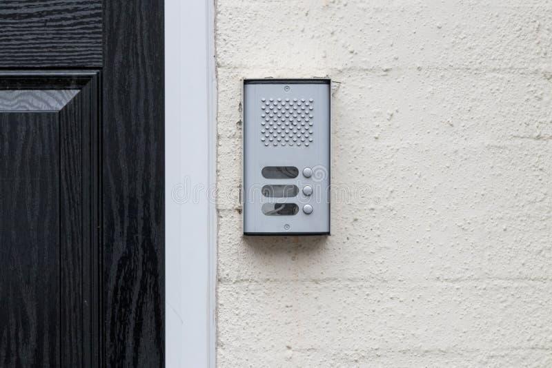 Flat door buzzer intercom stock photo