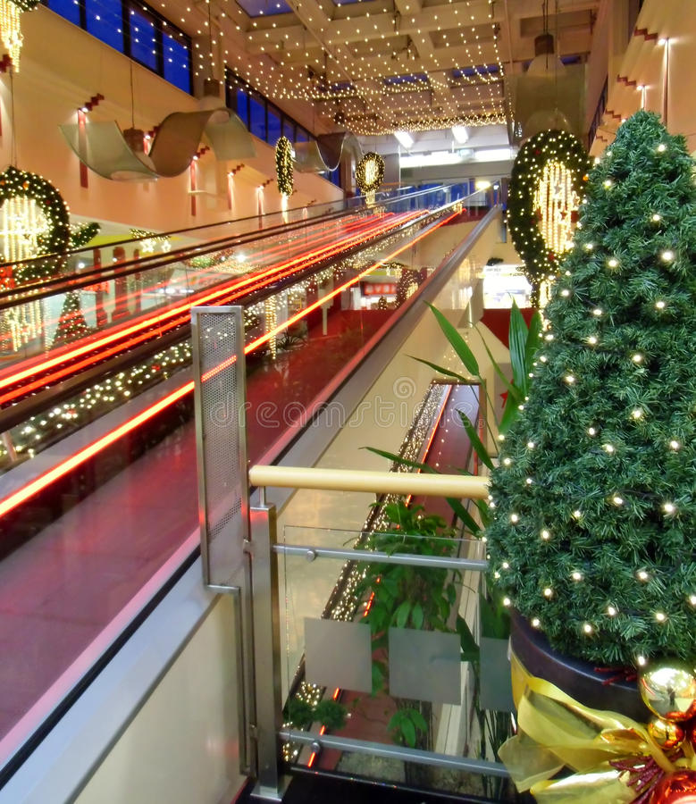 The flat escalator. In shopping center stock images
