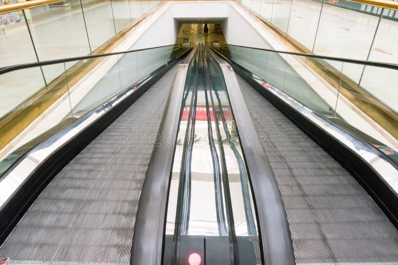 Flat escalators moving stock photos
