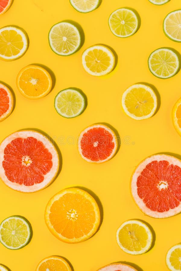Flat lat top view sliced citrus fruit yellow background royalty free stock photo