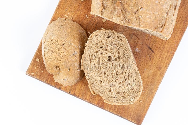 Flat Lay Above Chrono Bread With Cereals On The Board. Seed, whole, unleavened, flour, grain, bakery, flax, integral, wheat, diet, organic, sunflower, food stock photos