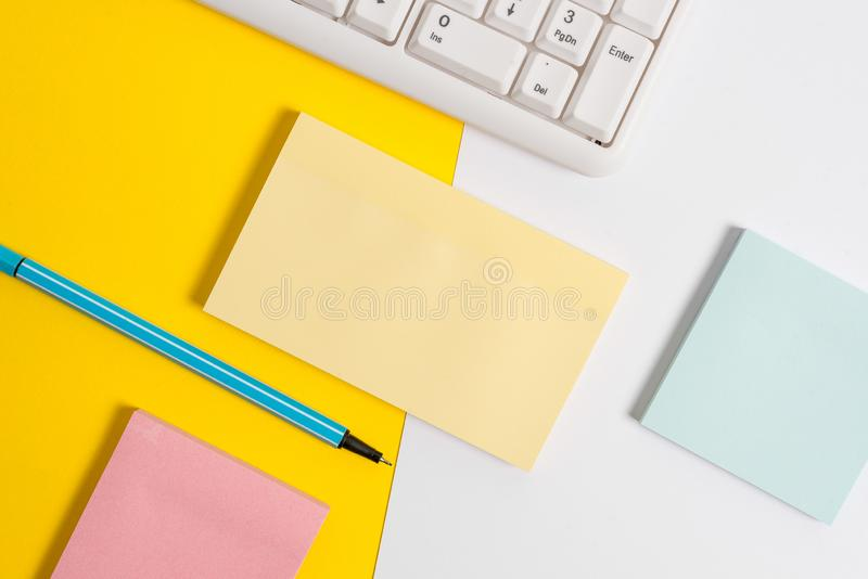 Flat lay above empty blank paper with copy space and pc keyboard above orange background table. Business concept with stock photo