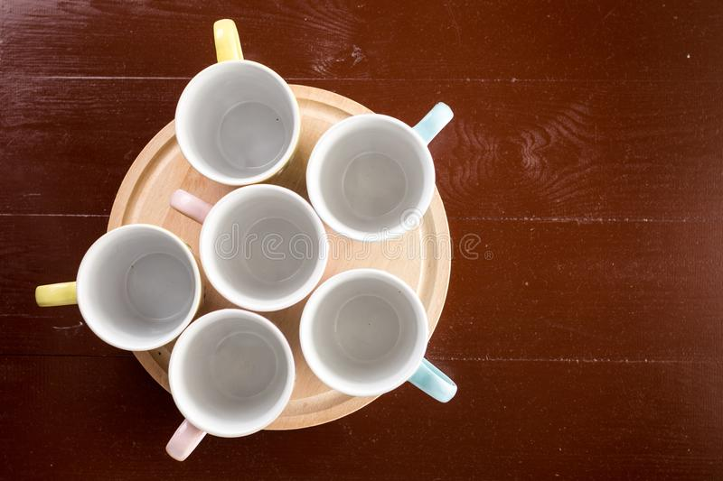 Flat lay above empty cups on the wooden board with copy space royalty free stock images