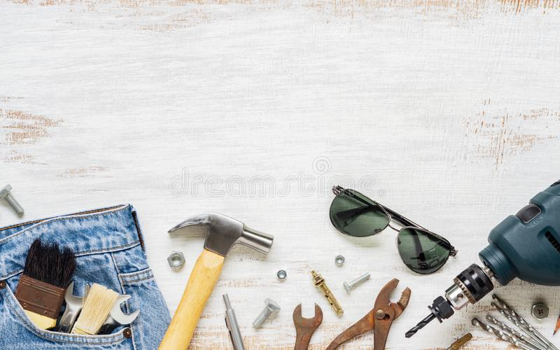 Flat lay accessories tools and clothing for worker on rusty white wooden with copy space. Blank space top view for labor or labour stock images