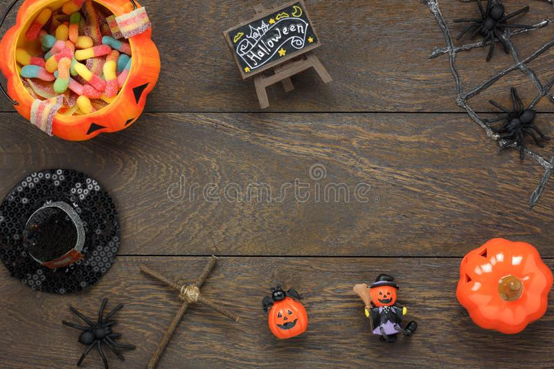 Flat lay of accessory decoration Happy Halloween festival background concept. Mix variety object on the modern rustic brown wooden at home office desk.Necessary royalty free stock photography