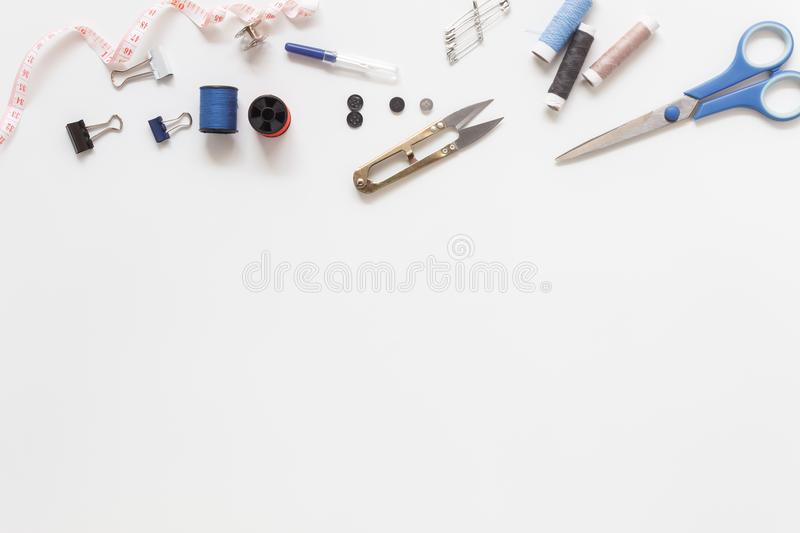Flat lay aerial image of fashion designer items. Background concept.Top view sewing accessory or tailor equipment on modern rustic white paper at home office stock photos