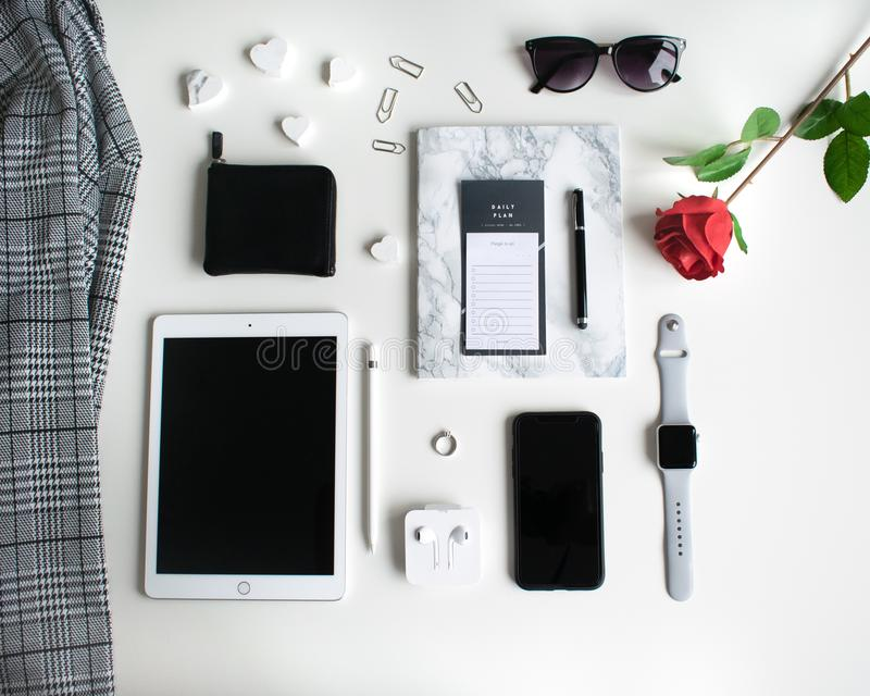 Flat lay: Apple products on black and white background. Additionally stock photography