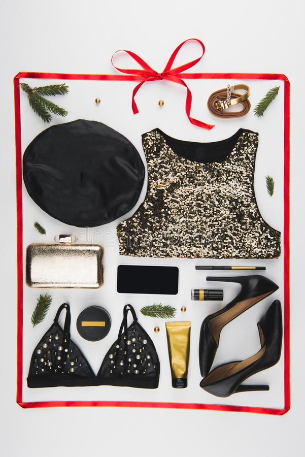flat lay with arranged feminine festive clothes, shoes and cosmetics isolated on white stock image