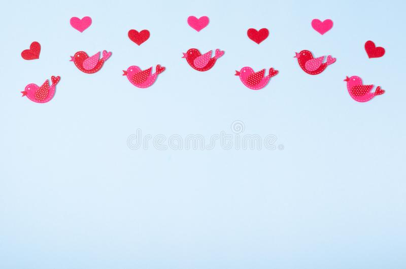Flat lay arrangement of birds and hearts for mock up design, table top view image of decoration valentine's day background. Concept for post card royalty free stock image