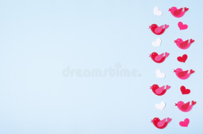 Flat lay arrangement of birds and hearts for mock up design, table top view image of decoration valentine's day background. Concept for post card royalty free stock photography