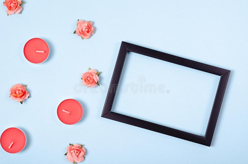 Flat lay arrangement of candles and flowers for mock up design, table top view image of decoration valentine's day background. Concept for post card royalty free stock images