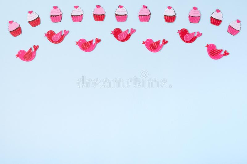 Flat lay arrangement of cupcakes and birds for mock up design, table top view image of decoration valentine's day background. Concept for post card royalty free stock photo