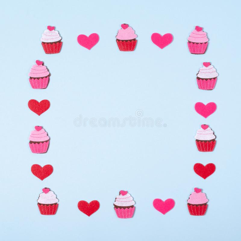 Flat lay arrangement of cupcakes and hearts for mock up design, table top view image of decoration valentine's day background. Concept for post card stock image
