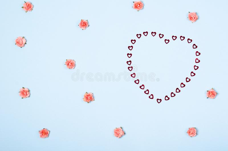 Flat lay arrangement of flowers and hearts for mock up design, table top view image of decoration valentine's day background. Concept for post card stock photo