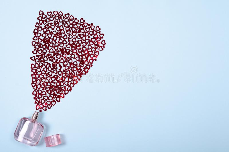Flat lay arrangement of hearts and perfume bottle for mock up design, table top view image of decoration valentine's day. Background concept for post card royalty free stock photography