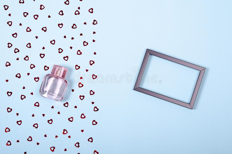 Flat lay arrangement of hearts and perfume bottle for mock up design, table top view image of decoration valentine's day. Background concept for post card royalty free stock photo