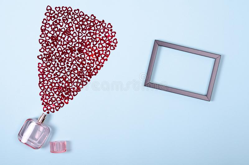 Flat lay arrangement of hearts and perfume bottle for mock up design, table top view image of decoration valentine's day. Background concept for post card royalty free stock photos