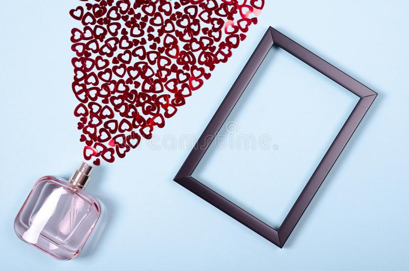 Flat lay arrangement of hearts and perfume bottle for mock up design, table top view image of decoration valentine's day. Background concept for post card royalty free stock images