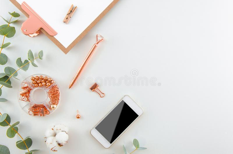Flat lay beautiful Stylish workspace. Fashion women blogger workspace with a smartphone, cotton flowers, eucalyptus royalty free stock image
