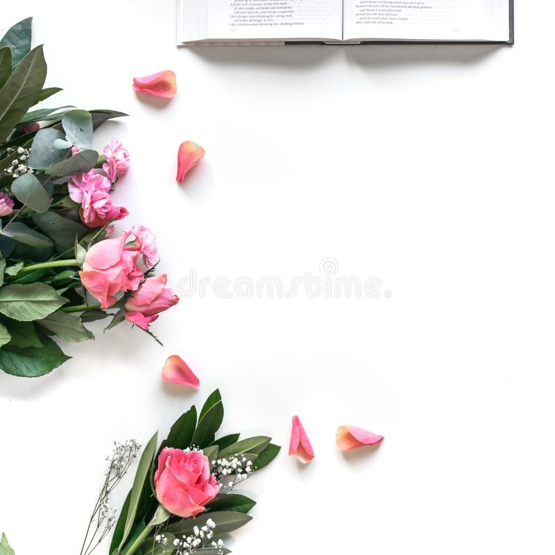 Flat lay: Bible and pink, red, rose flower bouquet. On white background stock photos