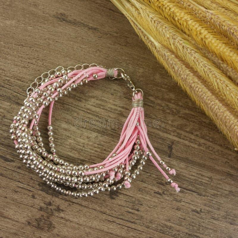 Flat lay bracelet on wooden background stock photo
