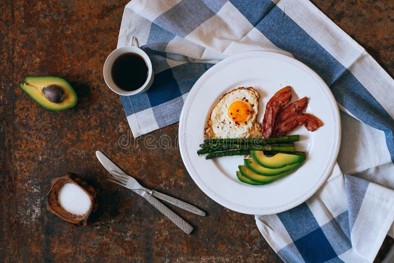 Flat lay breakfast with coffee, avocado, asparagus, egg stock photography