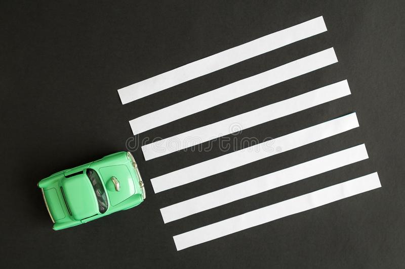 Flat lay of car toy on pedestrian crossing minimal creative concept royalty free stock image