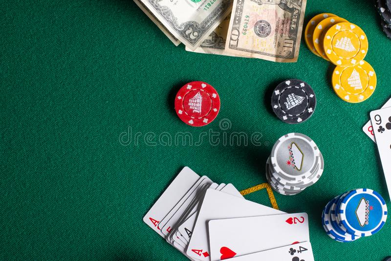 Flat lay Casino, night life, online gambling business games. Chips, cards and dollars on a green table with space.  stock images