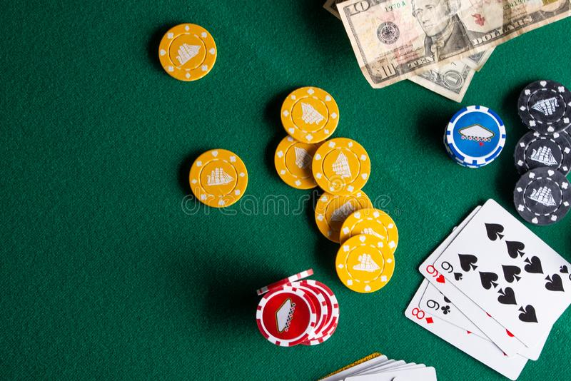 Flat lay Casino, night life, online gambling business games. Chips, cards and dollars on a green table with space.  stock photo