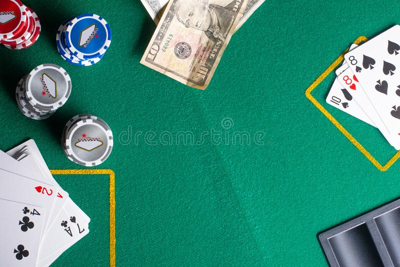 Flat lay Casino, night life, online gambling business games. Chips, cards and dollars on a green table with space.  royalty free stock photography