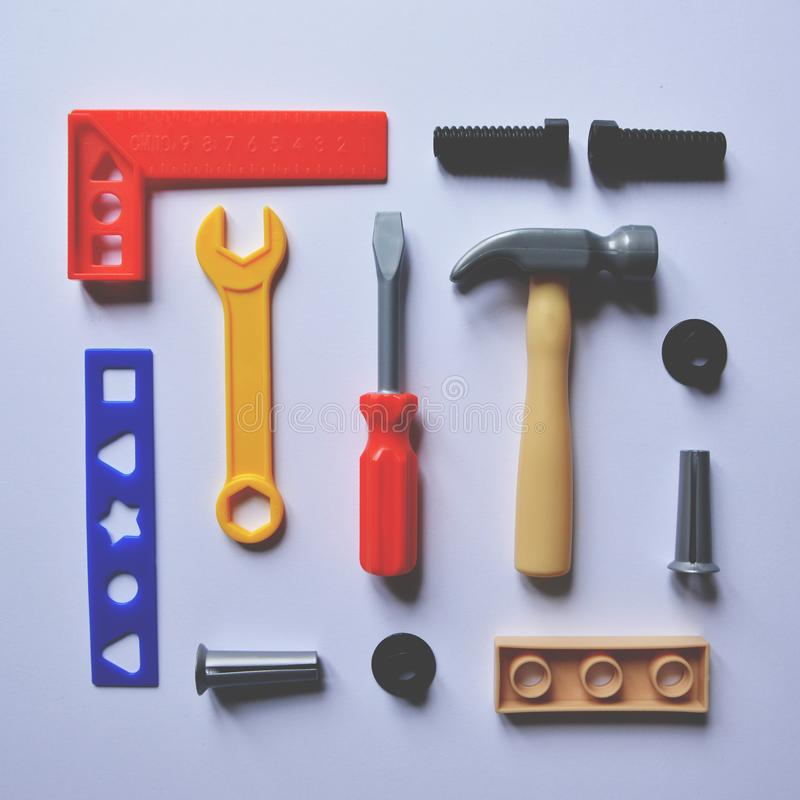 Flat lay of children plastic toy tools royalty free stock images