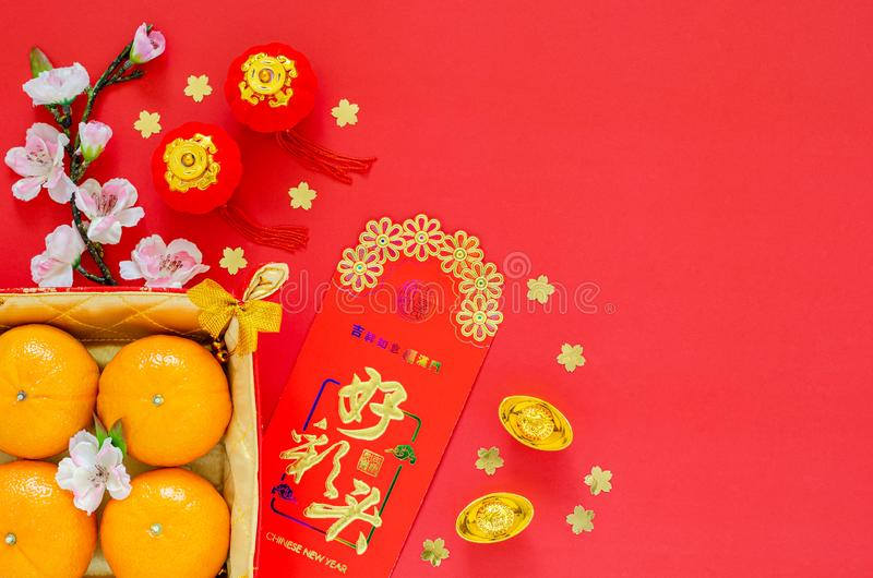 Flat lay of Chinese new year festival decoration on red background. royalty free stock image