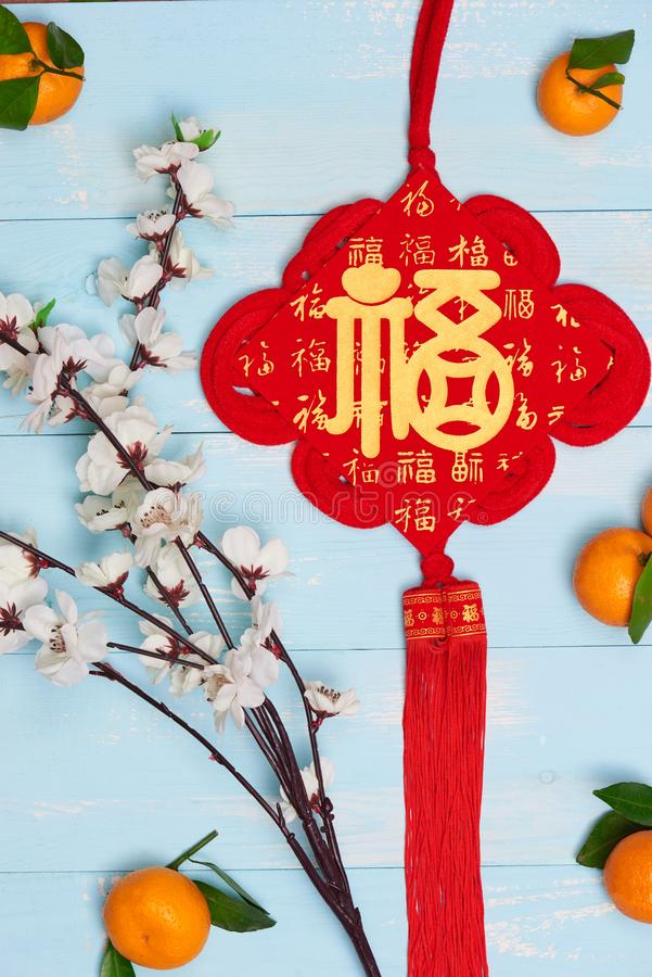 Flat lay Chinese new year tangerine oranges and plum blossoms on. Wooden table top royalty free stock photography