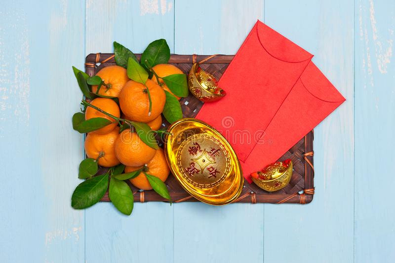 Flat lay Chinese new year tangerine orangeson wooden table top. stock image