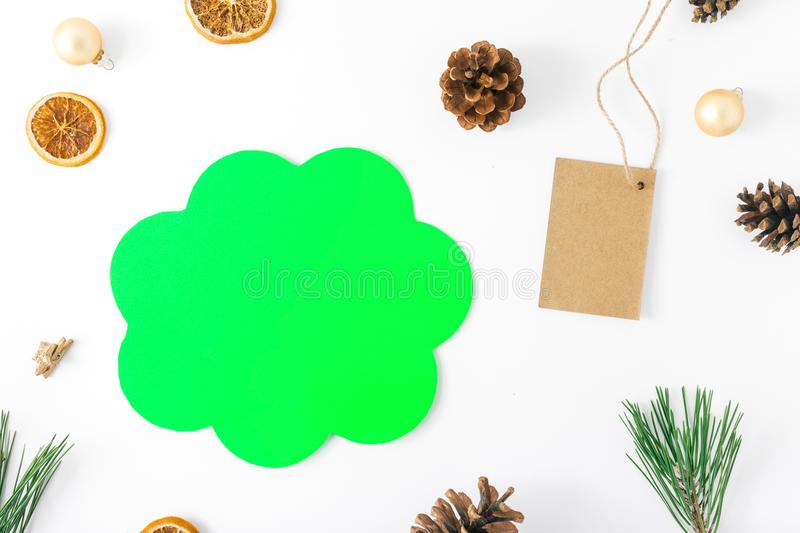 Flat lay christmas background, sign of thought, price tag, decor. Flat lay christmas background with sign of thought, price tag and decorations on white royalty free stock image