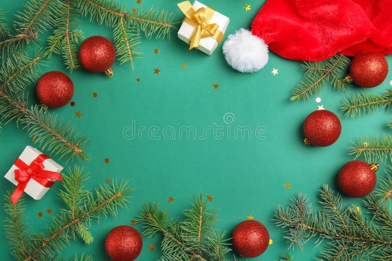 Christmas composition with festive decor and gift boxes on color background. Flat lay Christmas composition with festive decor and gift boxes on color background stock photo