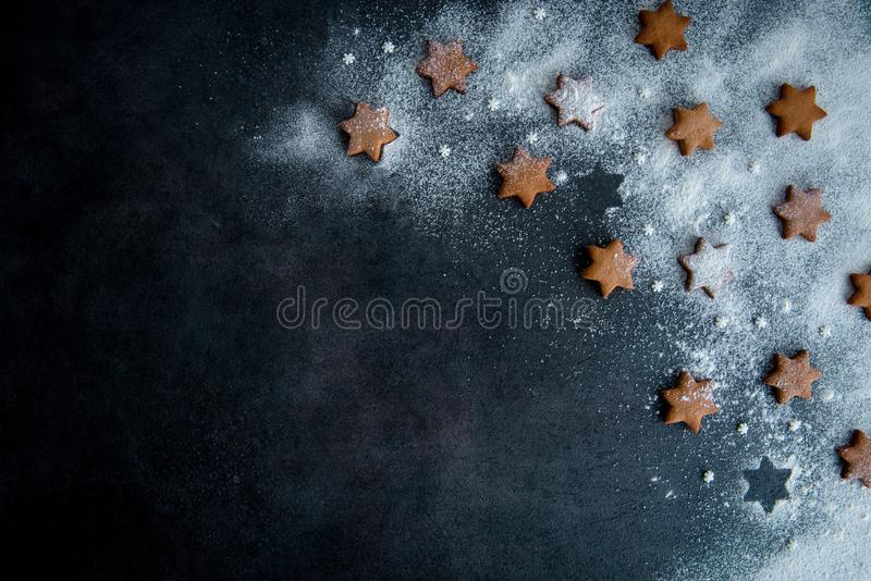 Christmas gingerbread star cookies on the dark blue background s stock image