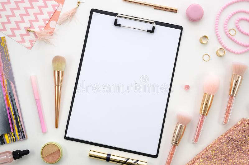 Flat lay clipboard mockup.Composition with cosmetics, makeup tools, on white background pink colors. beauty, fashion stock photos